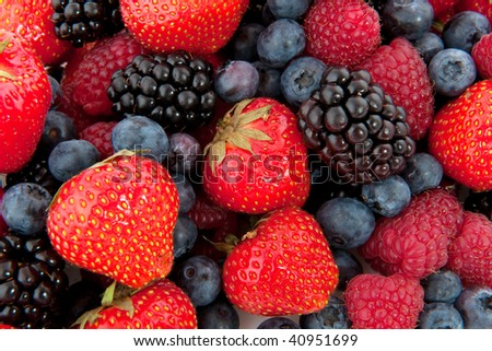 Diversity fresh forest fruit full as a background - stock photo