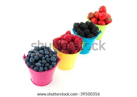 Diversity fruit in colorful buckets isolated over white