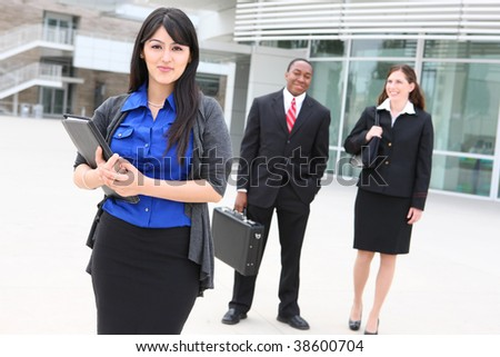 Diversity of attractive business men and women at office building - stock photo