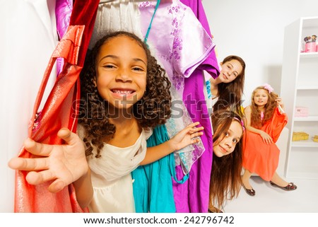 Diversity of girls during shopping choose clothes - stock photo