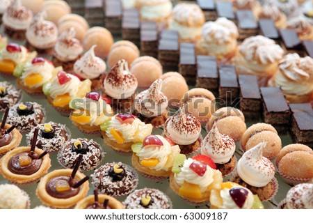 Diversity of pastry decorated with fruit - stock photo