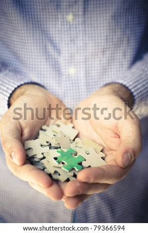 diversity of puzzle piece on handful - stock photo