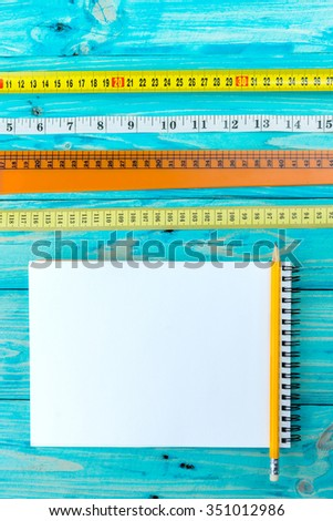 Diversity of types of lines for measurement. Notebook. top view. Vertical. wooden table