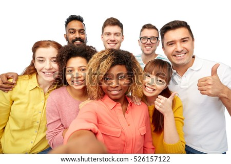 diversity, race, ethnicity, technology and people concept - international group of happy smiling men and women taking selfie over white