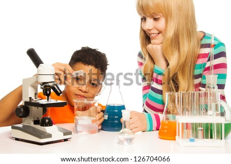 Diversity team black teen boy and blond Caucasian girl in the school laboratory - stock photo
