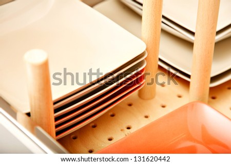 Divider in dish drawer - stock photo