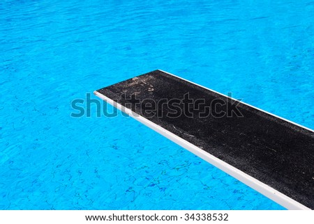 Diving board at a swimming pool - stock photo