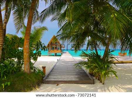 Diving club and cafe on a tropical island - travel background - stock photo