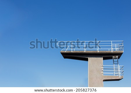 Diving platform from the side with a blue sky - stock photo