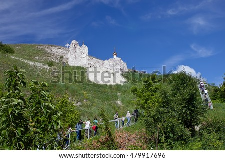 DIVNOGORIE, VORONEZH REGION, RUSSIA - JUNE 12, 2016: People walk upstairs to the cave church Orthodox cathedral carved out of natural rock, Russia, Voronezh region, museum Divnogorie in June 12, 2016