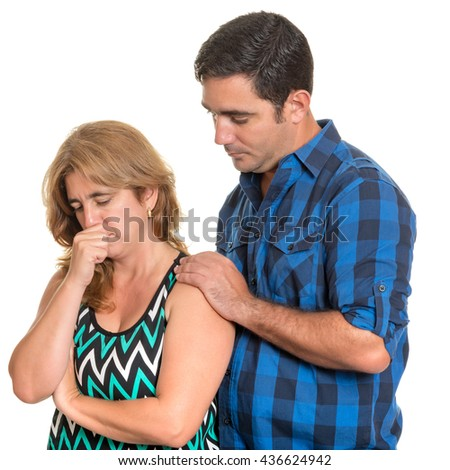 Divorce, Conflicts in marriage - Hispanic man consoling her sad wife - Isolated on white - stock photo