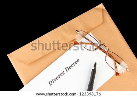Divorce decree and envelope on black background - stock photo