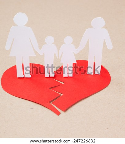Divorce effect on kids concept with hands cutting paper people family - stock photo