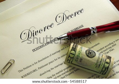 Divorce papers and cash with misc items - stock photo