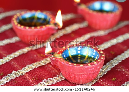 Diwali Diya with blurred lights in the background - stock photo