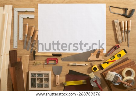DIY blank project with copy space and construction tools all around on a work table, top view - stock photo