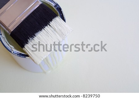 DIY home improvement paint brush on bucket or tin with copy space - stock photo