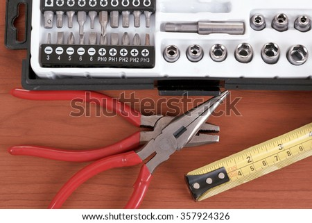 DIY work tools, screwdriver toolbox with set of bits, pliers and measuring tape - stock photo