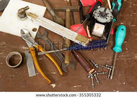 DIY workshop tools on table, untidy, ready for work