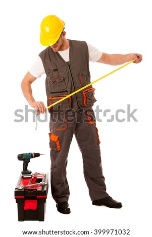 DIY - young man measuring with meter  equiped with toolkit and batery drill isolated over white