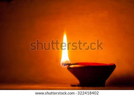 Diya lit up during diwali festival - stock photo