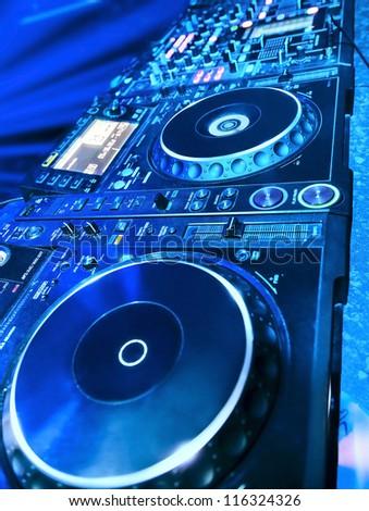 DJ CD player and mixer in nightclub - stock photo