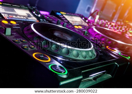 DJ CD player and mixer in nightclub - stock photo
