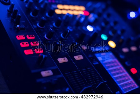 DJ console mixing desk at the night club - stock photo