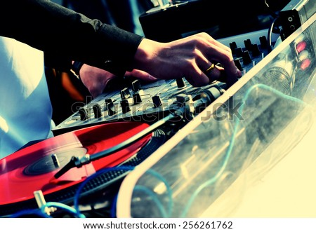 dj hands with the audio mixer - stock photo