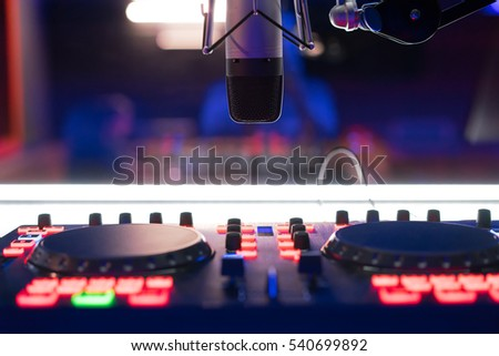 DJ mixer at a nightclub, a microphone. Workplace DJ. Mixing music.
