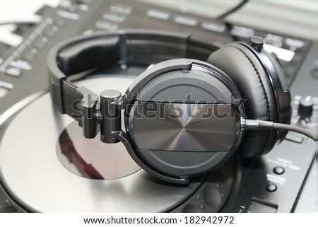dj mixer with headphones - stock photo