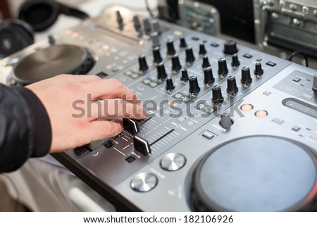 Dj mixes the track at party - stock photo