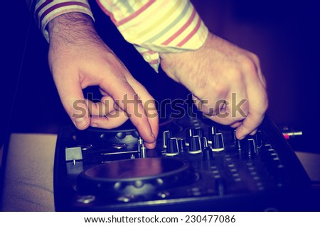 Dj mixes the track in nightclub at party  - stock photo