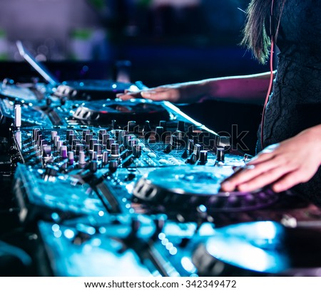 Dj mixes the track in the nightclub. - stock photo