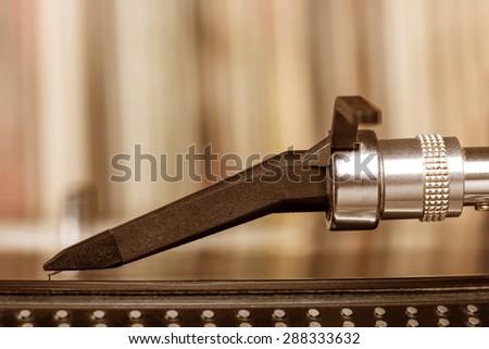 Dj needle stylus on spinning record, vinyl background   - stock photo