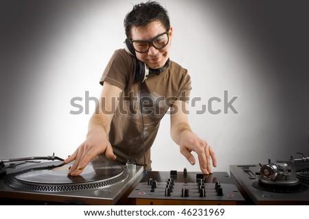 Dj playing disco house progressive electro music - stock photo