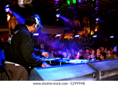 DJ spinning at a club - stock photo
