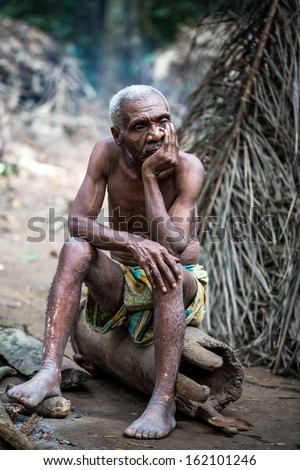DJA FOREST, CAMEROON - AUG 5: Ancient pygmy in the forest, forest pygmies Could Lose Their habitat due to logging companies and ivory traffickers on Aug 5, 2013 in the Dja forest, Cameroon - stock photo