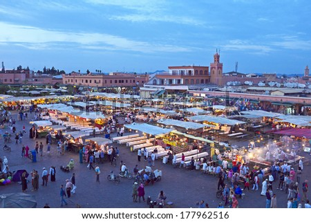 Djemaa el Fna market in Marrakesh, Morocco at sunset - stock photo