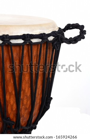 djembe, african percussion, handmade wooden drum with goat skin - stock photo