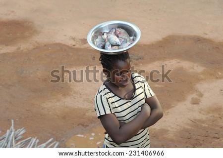 DJENNE, MALI, AFRICA - SEPTEMBER, 5, 2011 Woman selling fish at Djenne market - stock photo