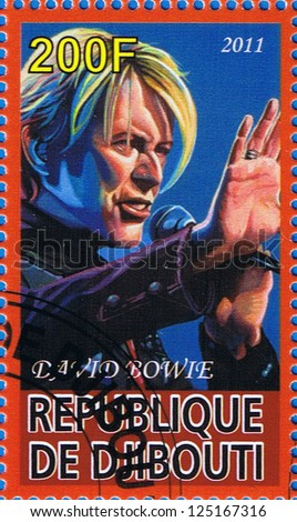 DJIBOUTI - CIRCA 2011: A postage stamp printed in the Republic of Djibouti showing David Bowie, circa 2011 - stock photo