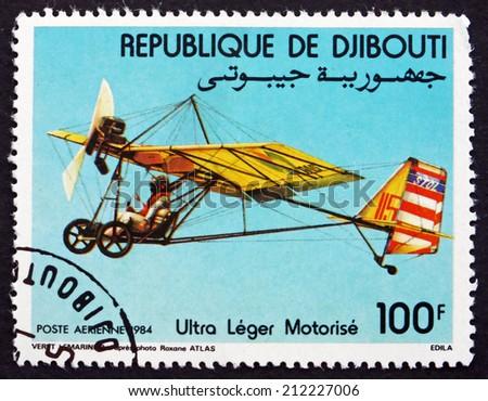 DJIBOUTI - CIRCA 1984: a stamp printed in the Djibouti shows Motorized Hang Glider, circa 1984 - stock photo