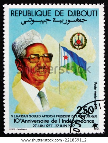 DJIBOUTI - CIRCA 1987: a stamp printed in the Djibouti shows President Hassan Gouled Aptidon, National Crest and Flag, 10th Anniversary of the National Independence, circa 1987 - stock photo