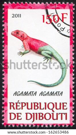 DJIBOUTI - CIRCA 2011: stamp printed by Djibouti, shows Agama, circa 2011 - stock photo