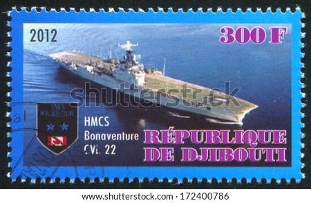 DJIBOUTI - CIRCA 2012: stamp printed by Djibouti, shows aircraft carrier, circa 2012 - stock photo