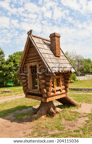 Dmitrov, Russia - June 07, 2014: Russian fairy tale house in Children park of Dmitrov, Moscow Region, Russia. In Russian folklore such house is a residence of witch Baba Yaga