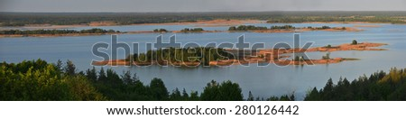 Dnepr river panorama. Islands covered with fores are illuminated with evening sun. Landscape from Vitachiv view point. - stock photo