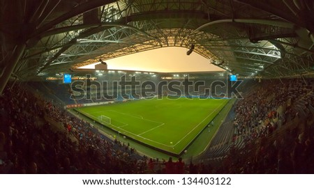 DNEPROPETROVSK, UKRAINE - APRIL 6: Dnipro Stadium Arena during Ukrainian Championship match FC Dnepr vs. FC Vorskla on April 6, 2013 in Dnepropetrovsk, Ukraine - stock photo
