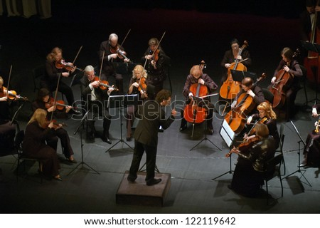 "DNEPROPETROVSK, UKRAINE - DEC.17: ""Four seasons"" Chamber Orchestra - main conductor Druzelub Yanakiev perform music of  Mozart, Elgar, Brittain, Dvorak on Dec. 17, 2012 in Dnepropetrovsk, Ukraine"
